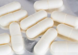White probiotic supplement capsules