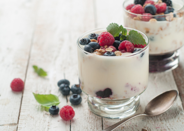 Homemade yogurt and fruit cups topped with berries and nuts