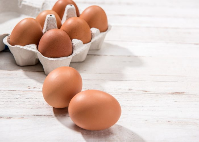 a carton of fresh eggs on a table