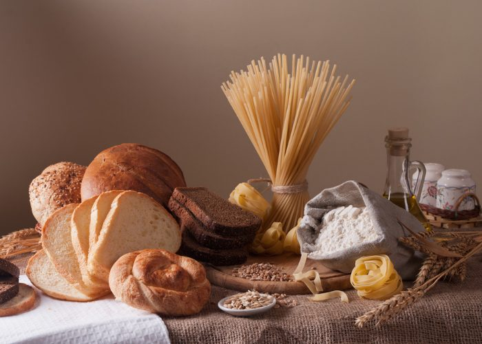 gluten foods such as pasta, grains, and breads on a table