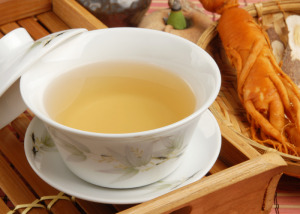 a cup of ginseng tea in a traditional chinese tea cup
