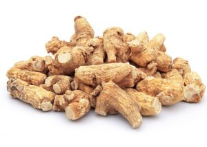a pile of dried ginseng root on a white table