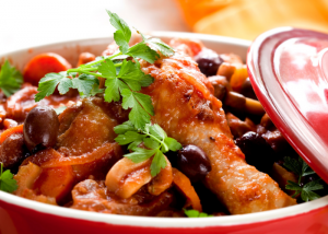 one pot meal of chicken, olives, and vegetables in a slow cooker
