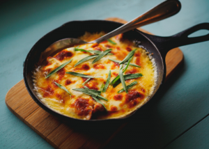 one pot meal of baked potatoes topped with cheese in a skillet
