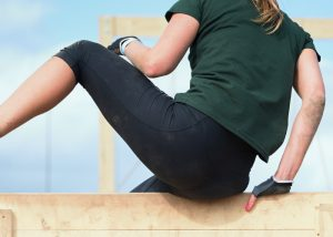 parkour girl with parkour gloves training on an obstacle course