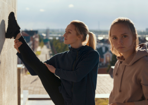 parkour women stretching on a rooftop