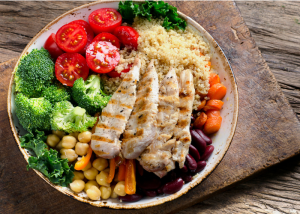 high protein salad with chicken, chickpeas, broccoli, tomatoes, kidney beans, carrots and cous cous