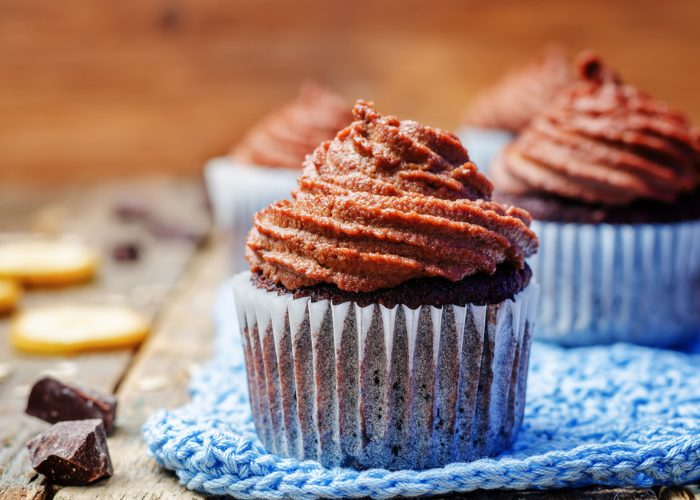 vegan gluten free cocoa cupcakes on a blue knitted cloth