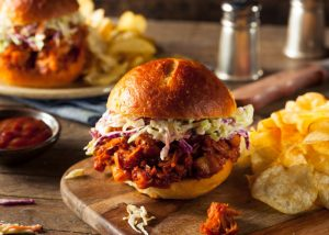 pulled jackfruit burger on a wooden board