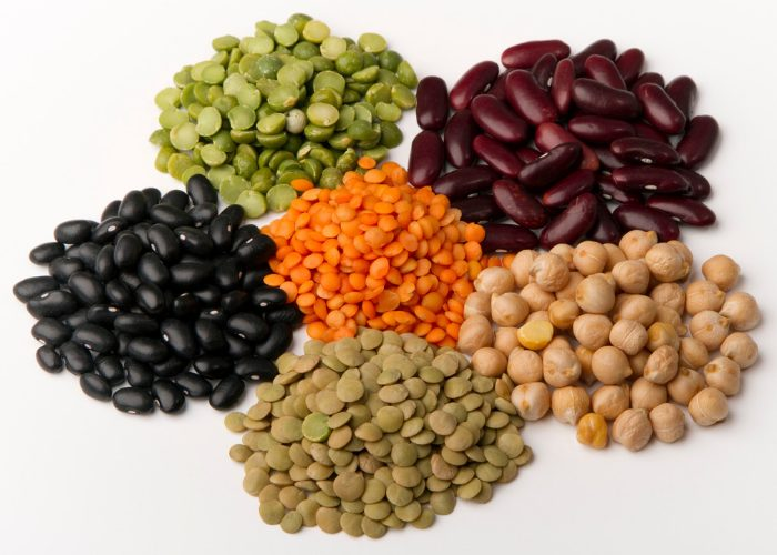 five different types of legumes on a table