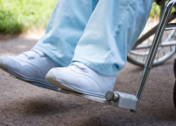 Close up of woman's shoes in wheelchair