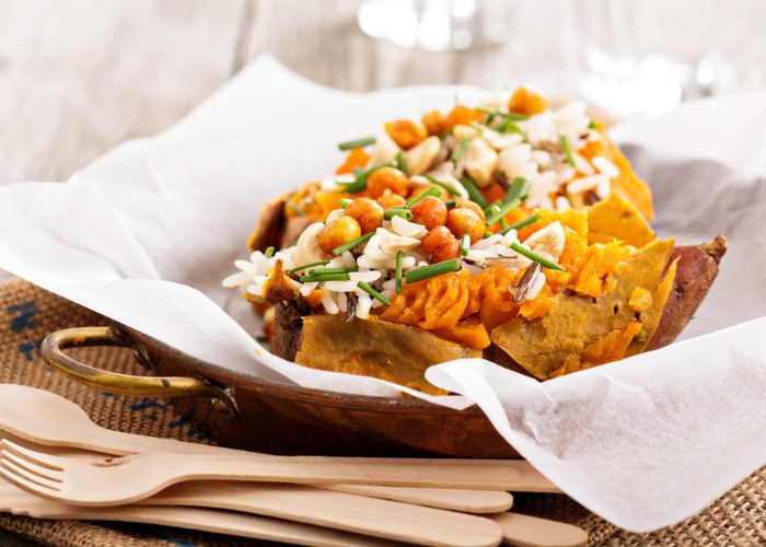 Plant-based meal of baked sweet potato topped with beans