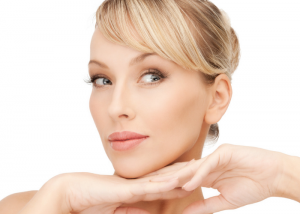 Woman's face with high cheekbones and a slim look after doing face yoga