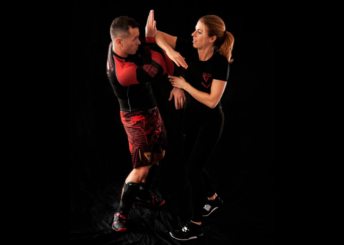 Woman practicing wing chun martial arts move on her partner