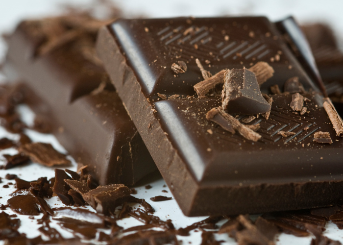 Close up of dark chocolate bar with shavings on top