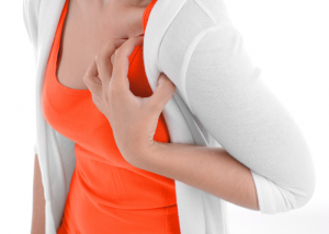 Woman holding her shoulder area in pain
