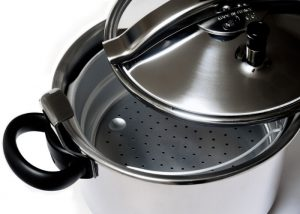 Aluminum pressure cooker with lid open