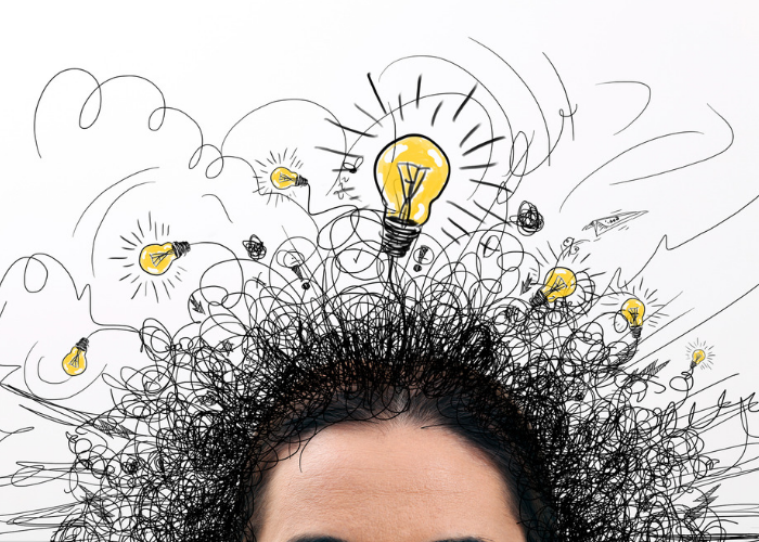 Woman's head with light bulbs and squiggles drawn above it to represent memory and thoughts