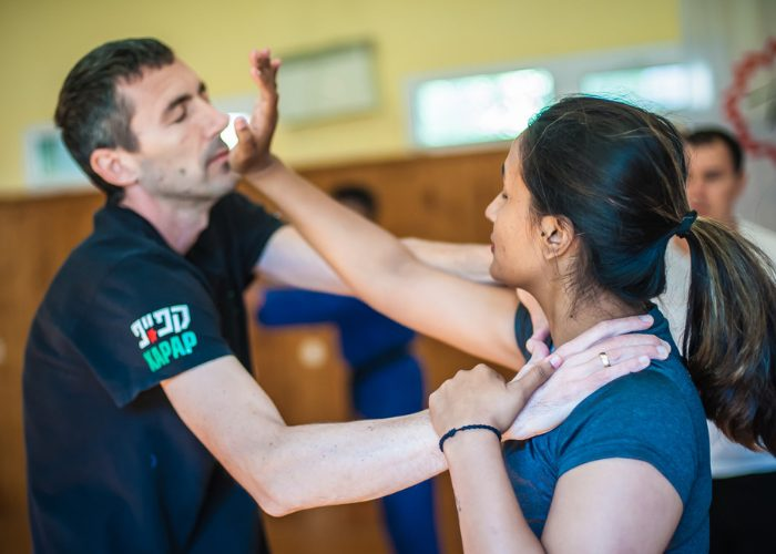 A woman practicing the Israeli martial arts, Krav Maga is a partner