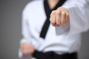 Close up of a karate black belt woman's fist