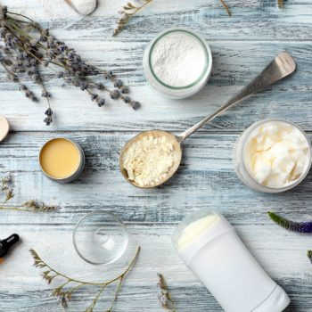 Ingredients for natural deodorant laid out neatly on a grey table
