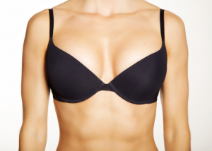 Focus on the torso of a woman wearing a black bra