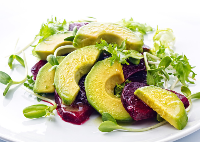 Plant-based meal of avocado, beetroot and sprouts salad