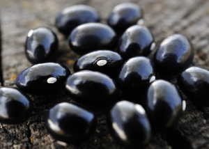 Close up of black beans on a wooden table