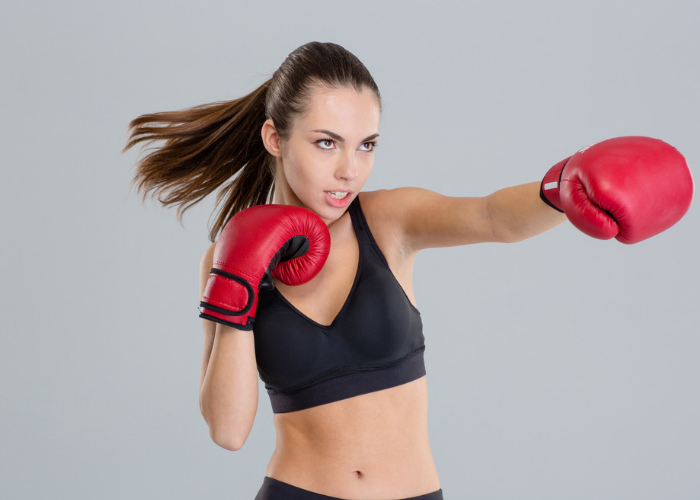 Young female boxer throwing a jab punch