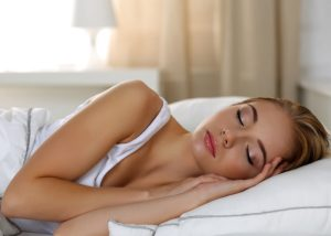 Woman sleeping soundly in bed