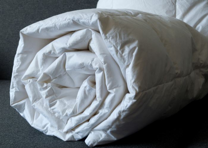 Rolled up white weighted blanket for adults