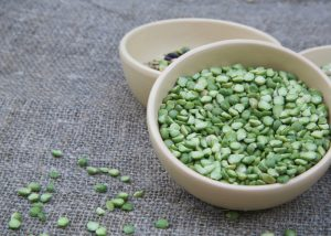 Green lentils in a ceramic bowl