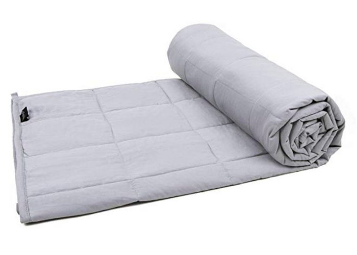 Light grey weighted blanket for adults half rolled up