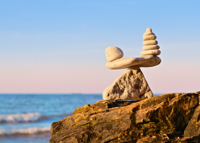 A structure of balancing rocks on a cliff by the seaside