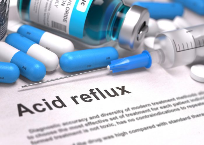 "Medicines on a document with large ""acid reflux"" text"