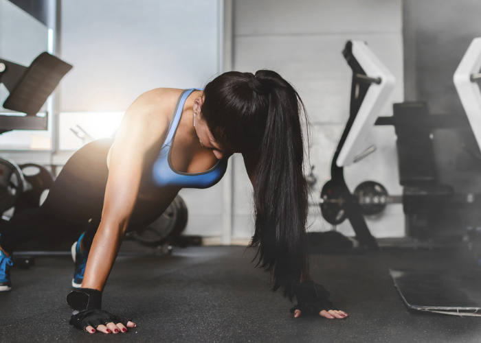 Woman doing pushups for cardio and arm training