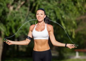 Woman doing cardio skipping exercises