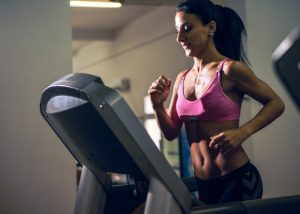Woman running on treadmill at the gym