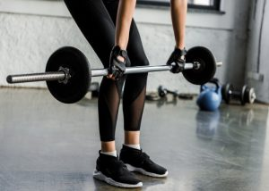 Woman doing deadlift strength training exercises