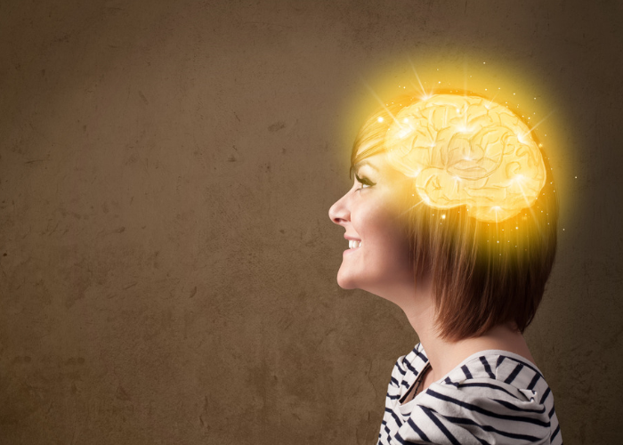 Woman side profile with graphic of a shining brain on her head