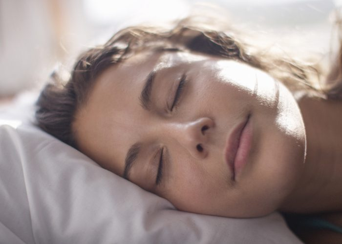 Close up of a sleeping woman's face