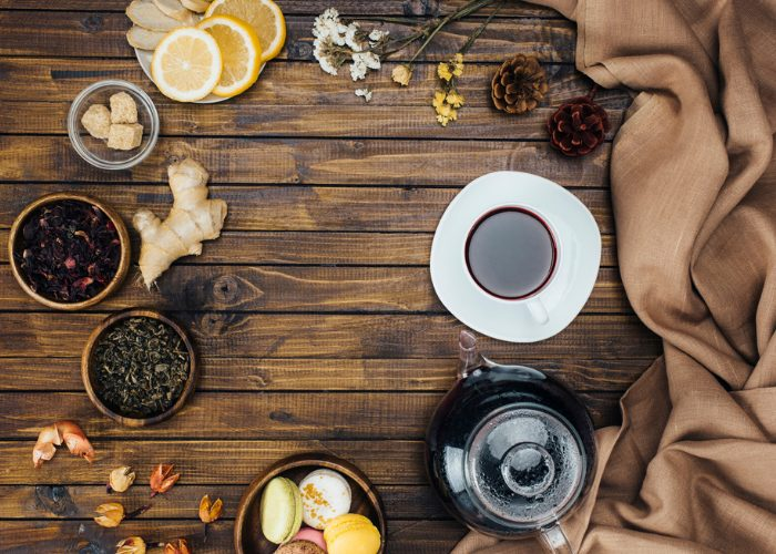 Top down view of various natural ingredients and herbs to make herbal tea