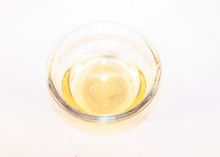 Small clear dish with white vinegar