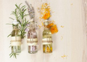 Three colorful vials of aromatherapy oils each with a different scent.