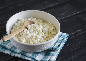 A bowl of cottage cheese on a teatowl