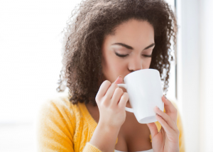 Woman drinking a cup of detox tea