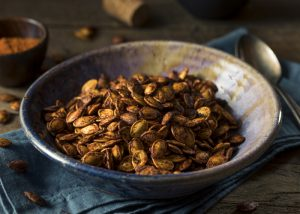 A bowl of homemade roasted pumpkin seeds