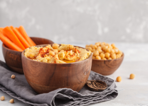 Bowls of hummus and carrot sticks
