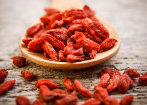 A wooden spoon with goji berries