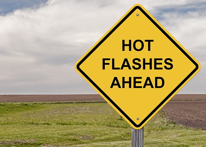 "Signboard written with ""hot flashes ahead"""